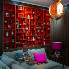 The walnut radiator cover in this den, with a pop of tomato red makes it strong statement in this cosy dimly light room - it disguises the radiator, turning something functional into something stylish.