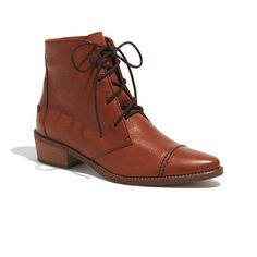 The Fielder Lace-Up Boot by Madewell, $208.00, can be worn to both formal and non-formal occasions. The pecan hue paired with the sleek look makes this ankle boot a must have for Fall skinny jeans!