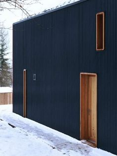 black vertical siding w natural cedar wrapped openings