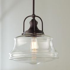 """Schoolhouse Bell Pendant This pendant puts a new spin on schoolhouse style. Curvy clear glass shades are paired with smart details, creating a look that is great for any space. Finished in Polished Nickel or Bronze. The height is adjustable and this fixture can be mounted on a sloped ceiling.Shade dimensions (16.5""""Hx14""""W). 90 degree swivel for sloped ceiling installation. Adjustable height up tp 45""""."""