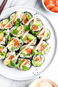 Salmon and Avocado Cauliflower Rice Sushi Roll Spicy Salmon and Avocado Cauliflower Rice Sushi Roll - a paleo and gluten free way to eat sushi!Spicy Salmon and Avocado Cauliflower Rice Sushi Roll - a paleo and gluten free way to eat sushi! Sushi Recipes, Avocado Recipes, Seafood Recipes, Paleo Recipes, Paleo Sushi, Avocado Ideas, Free Recipes, Gluten Free Sushi, Paleo Rice