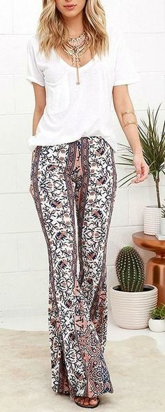 #boho #fashion #spring #outfitideas | White top + peach and navy floral flares