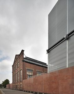 Brussels firm 51N4E have converted the industrial buildings at this former coal mine in Winterslag, Belgium, into a cultural centre.