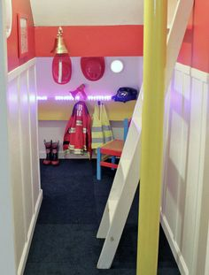 Fire Station & Play Kitchen under stairs. Under Stairs Playroom, Basement Stairway, Fireman Room, Firefighter Bedroom, Black Wainscoting, Playroom Design, Playroom Ideas, Basement Ideas, Kid Spaces
