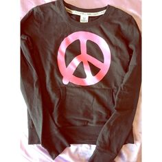 Peace sign Victoria Secret sweatshirt Super comfy hot pink and black VS sweatshirt with front pocket. Isn't very heavy so perfect for the spring! Good for a small or medium size Victoria's Secret Tops Sweatshirts & Hoodies
