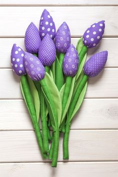 A bouquet of cotton, not wilting tulips. 9 flowers in violet color (small dots, large dots and flowers patterns). The leaves of tulips two-sided / two-tones. The size of a single flower is about 32-35 cm. COLORS MAY VARY FROM THOSE IN MONITOR. Myk Studio
