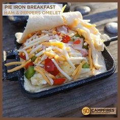 Iron Breakfast: Ham Omelet - 50 Campfires Pie Iron Breakfast: Ham Omelet - the perfect campfire breakfast!Pie Iron Breakfast: Ham Omelet - the perfect campfire breakfast! Campfire Pies, Campfire Breakfast, Ham Breakfast, Breakfast Recipes, Campfire Recipes, Camping Food Recipes, Breakfast Burritos, Grilling Recipes, Camping Food Pie Iron