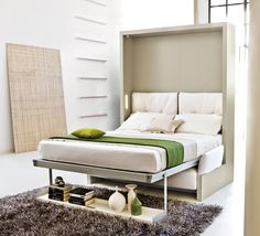 The Nuovoliola 10 sofa wall bed unit, converts with one simple movement into an everyday bed with wooden slatted base, there is a large storage space underneath the sofa. This unit is free standing. http://www.clei.co.uk/clei/phbin/nuovoliola/6b.jpg