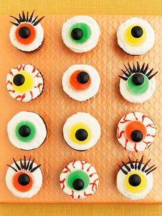 Cute Mini Halloween Cupcakes. How-to: http://www.midwestliving.com/recipe/cupcakes/eerie-eyeball-cupcakes