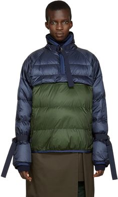 Long sleeve quilted down jacket in navy and dark green. Grosgrain cinch-straps…