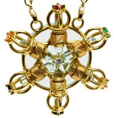 Buddha Maitreya 7 Ray Shambhala Star Radiator™ has a sacred geometric design based on the Star Tetrahedron (or Star of David) with 7 Ray (the 7 colors of the spectrum) or Planetary Ray (emeralds, sapphire and ruby outer stones) gemstones set into the dorje ends.
