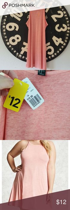 Forever 21 Cami Swing Dreas Neon coral Cami Swing dress. I so wish I liked the way it fits on me! It's pretty see through so you'll need something under it or for a cute swim cover dress. True to size. Brand new with tags still on Forever 21 Dresses
