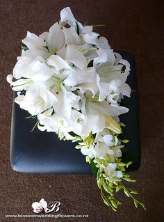 Lily drop bouquet for me  (Definitely looking at something like this..)