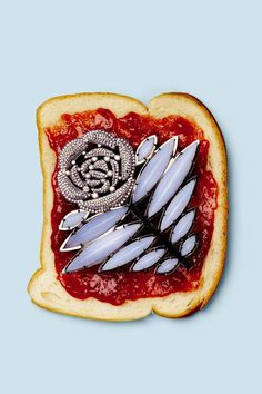 Product styling, still life, design, bread with jam + brooch