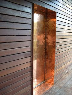 Ran wood slats, stained dark. Beverly skyline residence by bercy chen studio - copper clad door. Door Design, Exterior Design, Interior And Exterior, House Design, Interior Doors, The Doors, Entrance Doors, Windows And Doors, Metal Facade