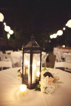 We can mix in lanterns with small clusters of flowers with all floral centerpieces to give the decor some variety. Very romantic.   Beautiful wedding table decorations!