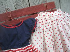 Isn't this the sweetest little doll dress? ...and it's made out of a hankie! I am not much of a doll collector... ...but I adore handmade...