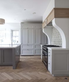 Classic kitchen design with a focus on Country Chic. A creative yet luxury interior that creates a warm family space. Call us today to visit our showrooms. #luxurykitchendesigns