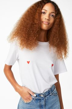 Wear your heart on your tee with this swoon worthy fashion piece. With 100% organic cotton, this tee is all about <3.