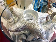 Starfish Tea Light Display Says Summer Fun – Fixtures Close Up Retail Merchandising, Glass Containers, Starfish, Summer Fun, Tea Lights, Close Up, Display, Floor Space, Billboard