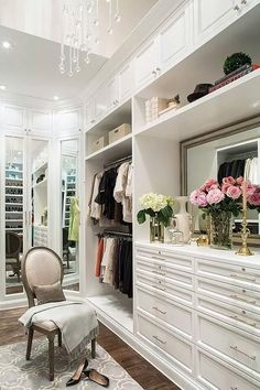 Enchanting and elegant white closet design with a touch of flowers!