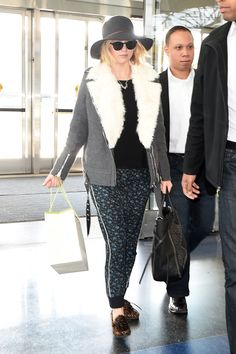Lawrence was spotted at LAX wearing floral sweats, a shearling-trimmed moto jacket, and super rad leopard Isabel Marant moccasins that we might have tried to steal in the security line.