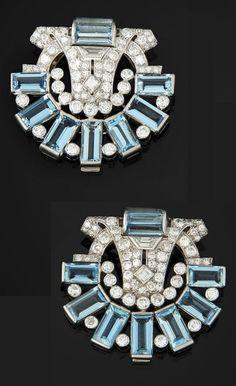 A pair of Art Deco or Art Deco-style platinum, gold, aquamarine & diamond clips, by Cartier. 3.6 x 3.4cm.