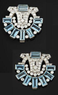 A pair of Art Deco or Art Deco-style platinum, gold, aquamarine & diamond clips, by Cartier. 3.6 x 3.4cm.