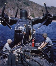 Refuelling from a barge. BTW, the Martin Mariner PBM was a Flying Boat, not a Floatplane.