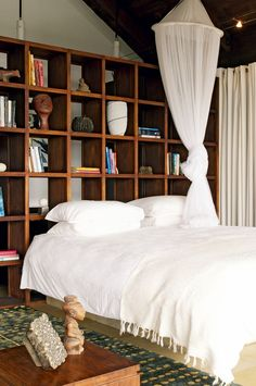 We love the idea of shelves as a headboard./room divider