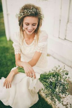 """A Smiling Bride Wearing A Dainty Crown Of Gypsophila, & Holding Her """"Rustic""""…"""