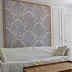 I love this concept, if you have textured walls this could be an option - a framed piece of fabric or canvas stenciled as a large backdrop!