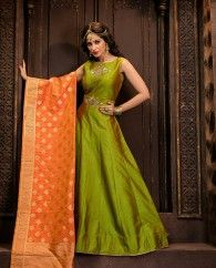 1. Green silk anarkali suit 2. Embellished yoke with patch work 3. Comes with a matching shantoon bottom and silk dupatta 4. Can be stitched upto bust size 42 inches and top length 50 inches