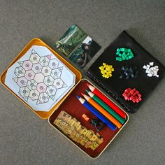 A mini Settlers of Catan board! The maps are one-time use. I could totally grab some Altoids tins or small boxes from the dollar store and make this as a gift.