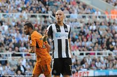 Shelvey is alleged to have hurled racial abuse at Wolves' Moroccan man, Romain Saiss (left)