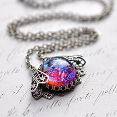 Dragon's Breath Necklace, Vintage glass opal wrapped in silver Filigree on Etsy, $31.00