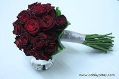 Beautiful Black Magic Roses accented with pewter ribbon.