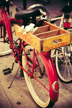 dreaming about pedaling around on a vintage red bike, loaded w/ coke