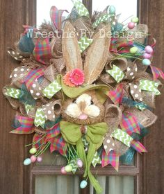 **Note I am out of the green bunny .I have the same bunny with a pink hat and bow tie.This adorable burlap bunny is on burlap with multi color easter ribbons and easter egg sprays 24 inch wreath size
