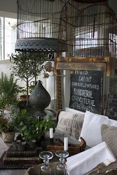Bird cages and chalk boards on a farmhouse porch!  What more could you ask for?