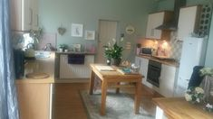 Kitchen island made from dining table :)