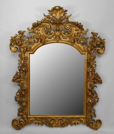 Nineteenth century Italian wall mirror set within a giltwood frame extensively carved with foliate and filigree Rococo decorations beneath a pronounced pediment top. Wall Mirrors Set, Old Mirrors, Home Decor Mirrors, Mirror Set, Frames On Wall, Baroque Pattern, Fireplace Mirror, Framed Tv, Beautiful Mirrors