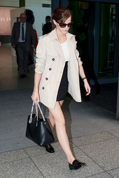 Heathrow Airport - March 5 2014  Emma Watson in a Winser London trench coat.
