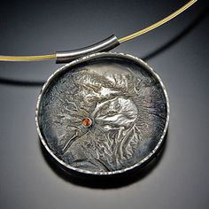 Topographic Moon Reticulated sterling silver with padparadscha sapphire. In a private collection.