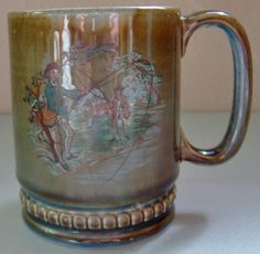 This lovely coffee mug was made by Wade China in Ireland.  On one side of the mug is a scene with a running river & trees with a couple of fly fishermen wading the river trying to catch some fish.  The colors of the mug are gorgeous, especially the interior blue color.  Nice! $39.99