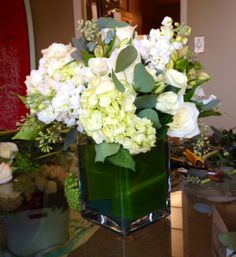 Here is our finished version of an all white floral arrangement. We made eight of these!