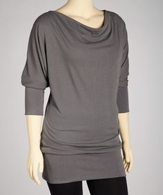 A universally flattering style, this cowl neck tunic adds slimming elegance to any ensemble through a loose silhouette and draped neckline—artfully crafting clean lines and steering the eye away from the tummy. Size note: This item runs a size small. Please refer to size chart.