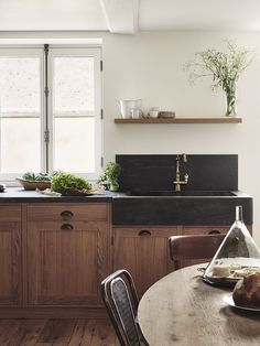 The wood and black sink compliment so well! Love the floating shelf!