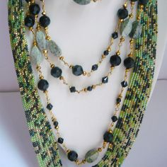 Green and Black Jewelry Statement Long Multi Strand Boho style... ($120) ❤ liked on Polyvore featuring jewelry, necklaces, strand necklace, multi strand chain necklace, multi-chain necklace, long strand necklace and multi strand beaded necklace