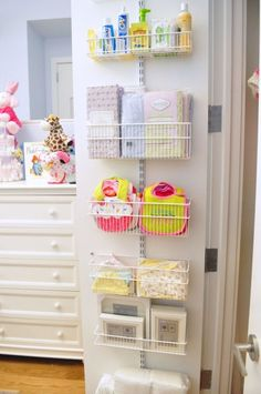 DIY Closet for Baby - Love the extra storage on the back of the closet door.